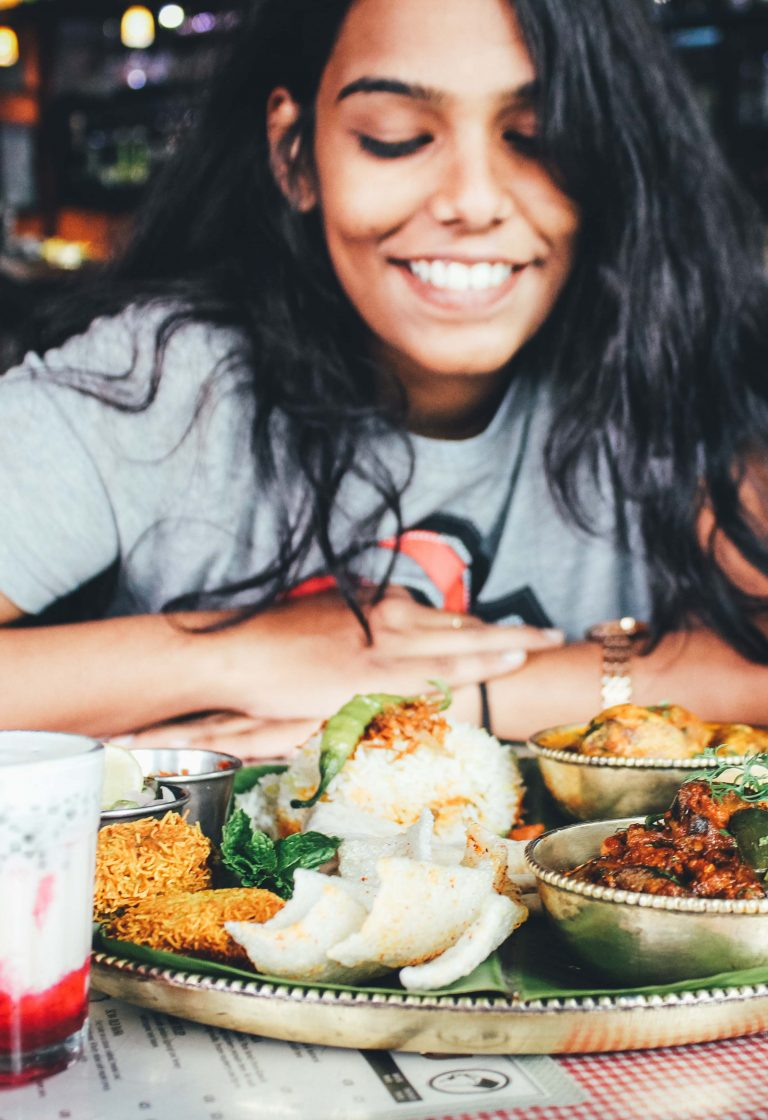 Woman looking happily at plate of food